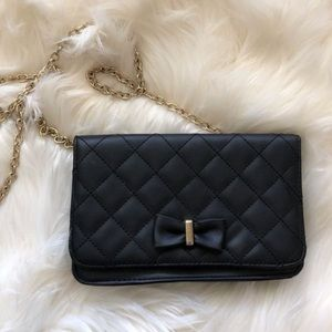 Quilted black bow purse